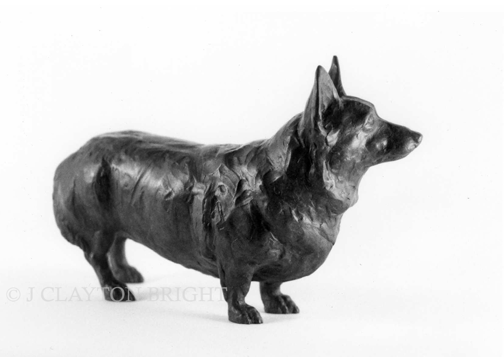 Realistic bronze sculpture of a Corgi dog looking ahead expectantly