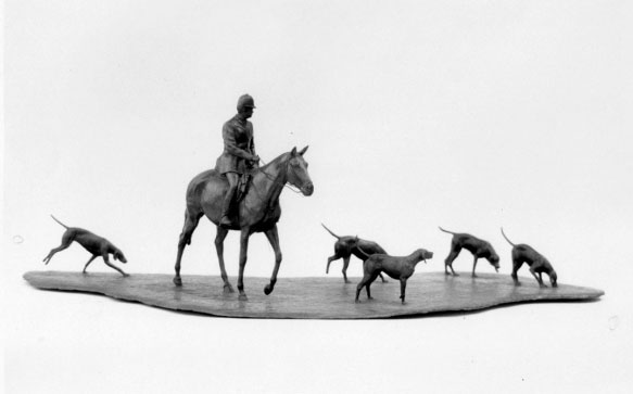 Table size bronze sculpture of man riding horse with five hounds