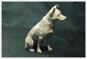Realistic bronze sculpture of a Jack Russell Terrier dog alert and ready for action