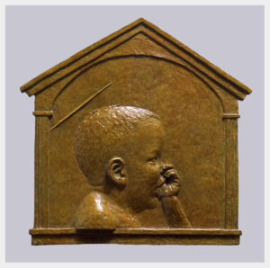 Realistic bronze bas relief sculpture of a toddler sucking his thumb with a subtle halo including framing with Renaissance architectural molding