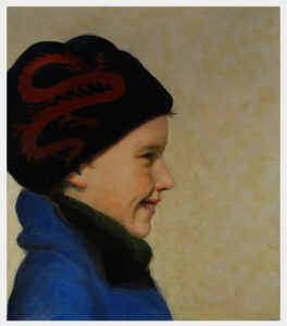 Realistic portrait in profile of a young boy wearing a hat with a dragon design outside in winter.