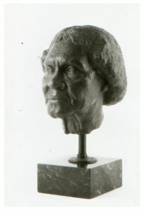 Realistic bronze sculpture life-size of an elderly African American woman on a marble base