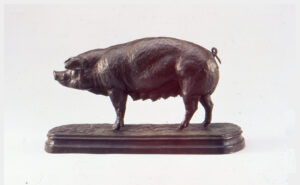 Realistic bronze sculpture of a nursing sow standing on a base