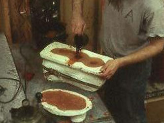 Next, wax is poured into the rubber mold to create the sculpture in wax.